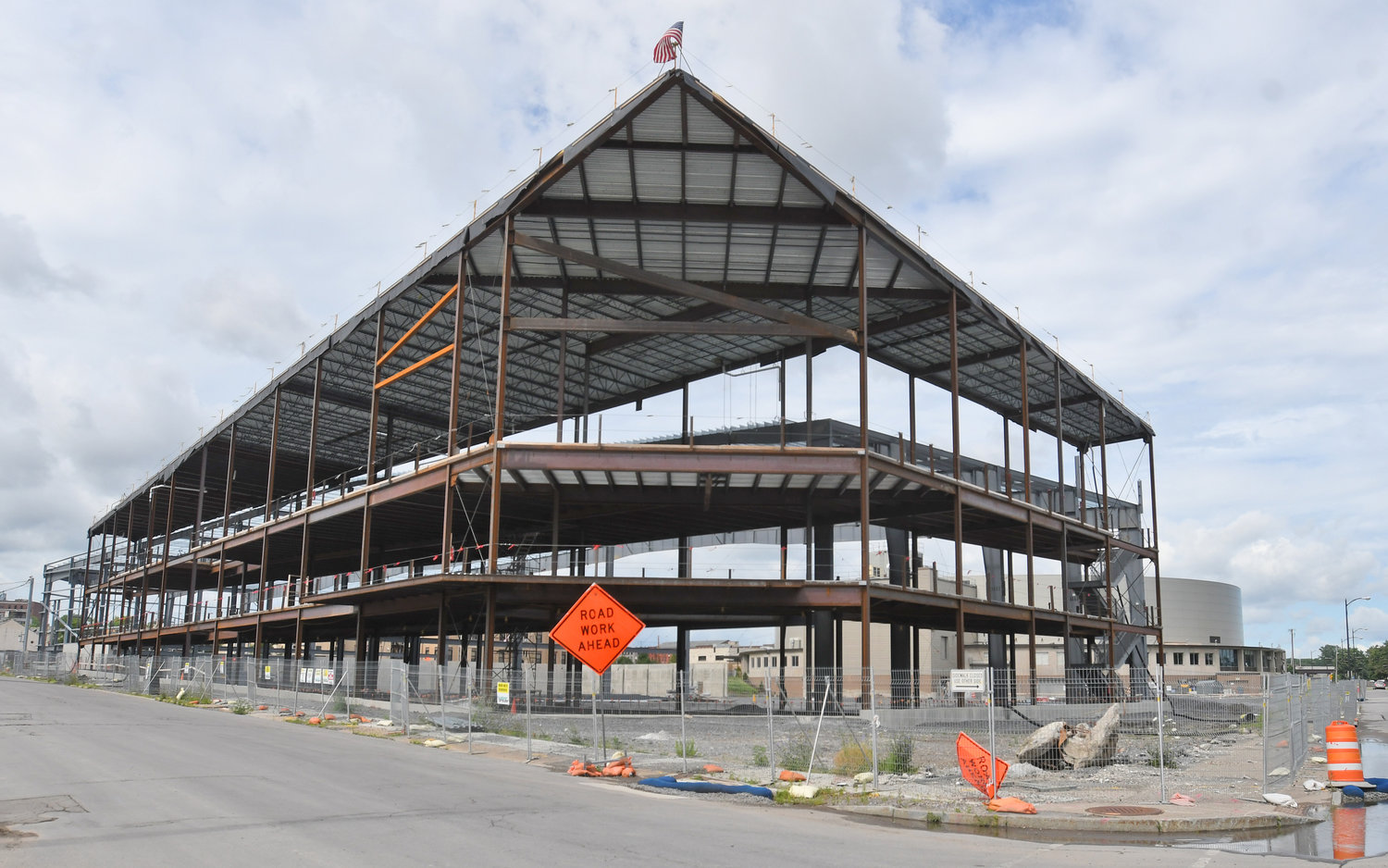 ON HOLD — Construction remains paused on the tournament-sports complex known as the Nexus Center on Oriskany Street in Utica. The 170,000-square foot, $40 million building is to have venues for sports tournaments, including hockey, indoor soccer and lacrosse, and is being built on land immediately east of the existing Adirondack Bank Auditorium, home of the Utica Comets minor-league professional hockey team. It is to be paid for through bonds issued by the Upper Mohawk Valley Auditorium Authority, some of the revenue from an increase in Oneida County's accommodations tax, and with some $22 million from New York State, but because of loss of state revenue related to the COVID-19 pandemic, construction was paused this spring.