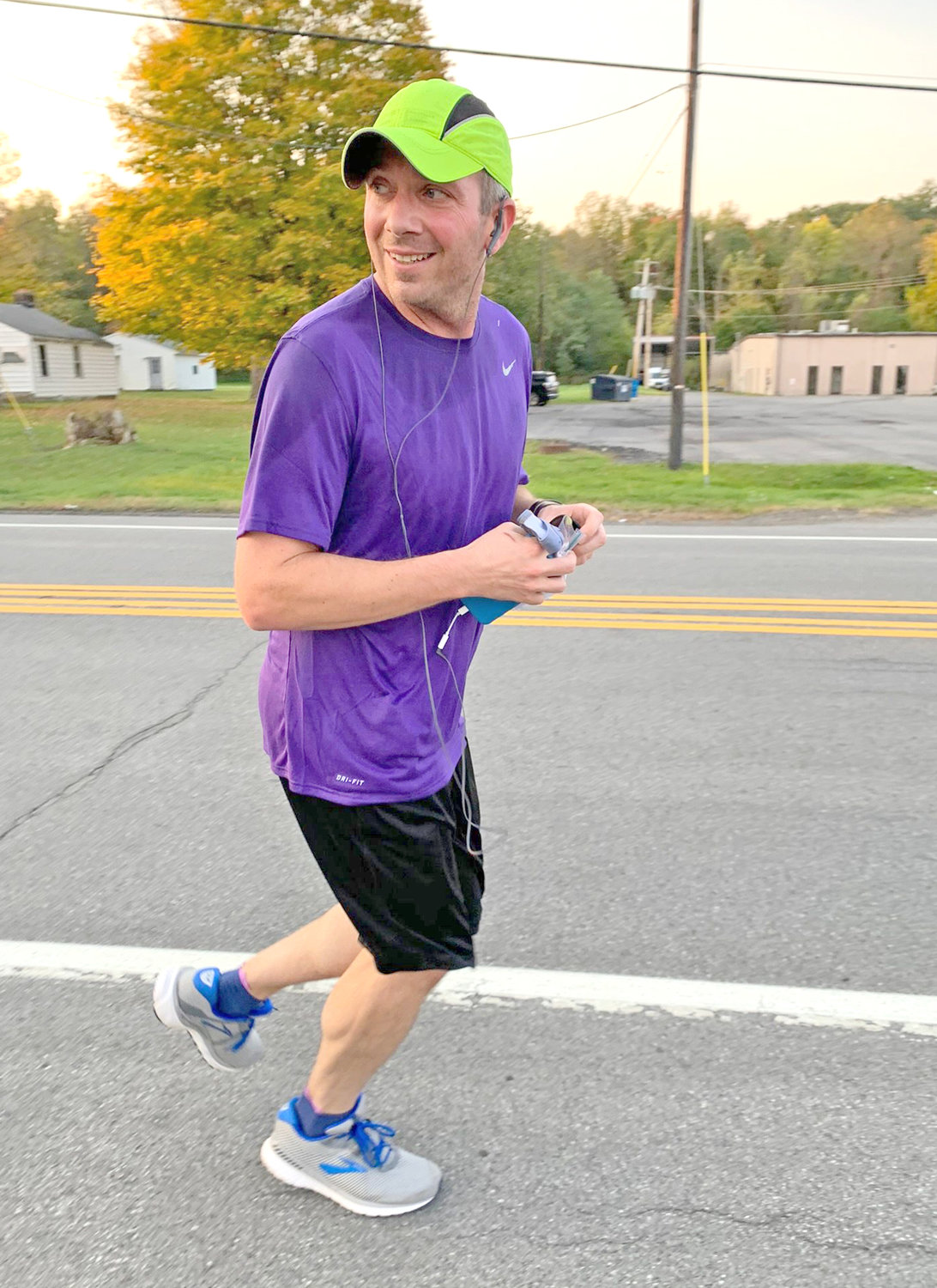 ON THE RUN — Mike Hoover, of Clinton, sets out on his virtual marathon during the morning of Oct. 10 to raise money for the Alzheimer's Association.  In his first marathon, run just over 4 hours within Clinton and New Hartford, Hoover was able to raise more than $3,500.