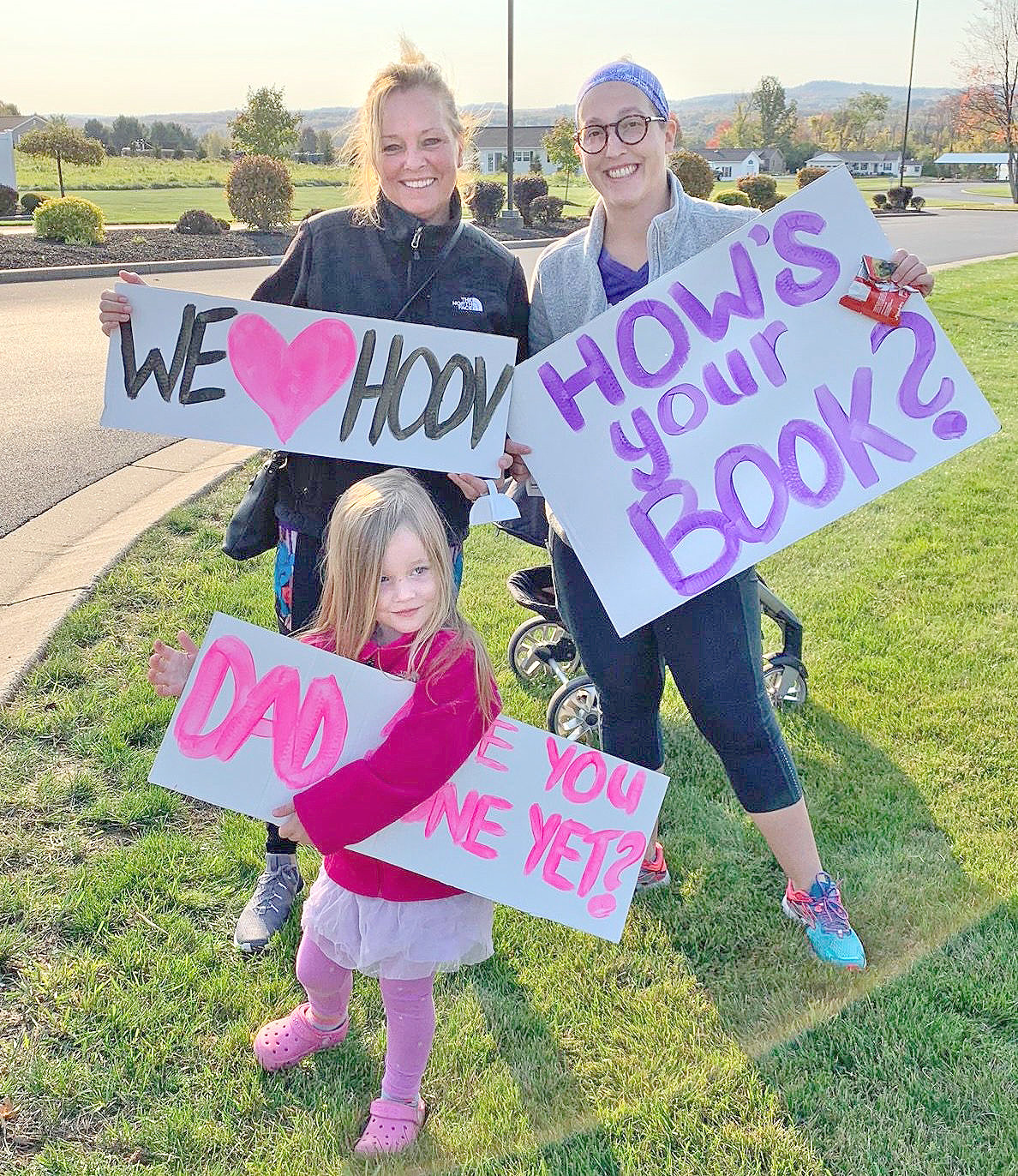 GIVING THEIR SUPPORT — Members of the Hoover family were out the morning of Oct. 10 rooting on Mike Hoover, of Clinton, who ran his first virtual marathon while raising money for the Alzheimer's Association.