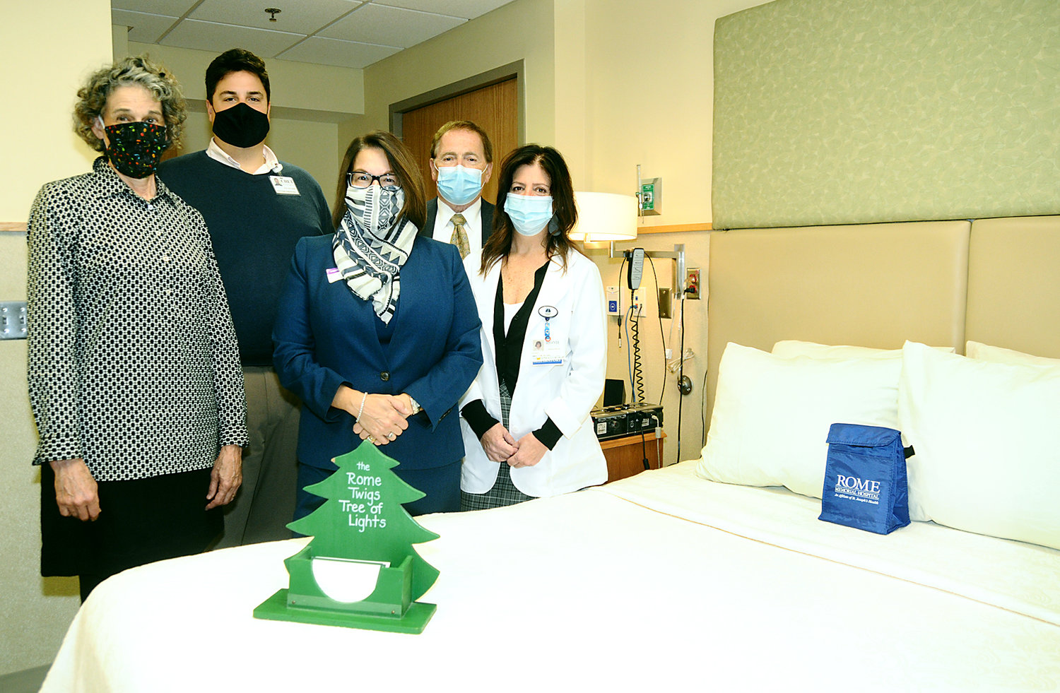 TWIGS KICK OFF TREE OF LIGHTS — Pictured inside the Sleep Disorders Center at Rome Memorial Hospital with the new Sleep Number adjustable bed which was donated by the Twigs are from left: Susan Williams, co-chair of the Rome Twigs Tree of Lights; Chet DiBari III, executive director of the Rome Hospital Foundation; Christina A. Barry and Kevin T. Barry, owners of Barry Funeral Home and Eileen Luley, service line administrator for cardio pulmonary and sleep services at Rome Memorial Hospital. Barry Funeral Home is the sponsor of the event, which will take place Sunday, Dec. 6 at 6:30 p.m. Last year's campaign raised over $10,000, which the Twigs then donated to programs that benefit patient care at the hospital.