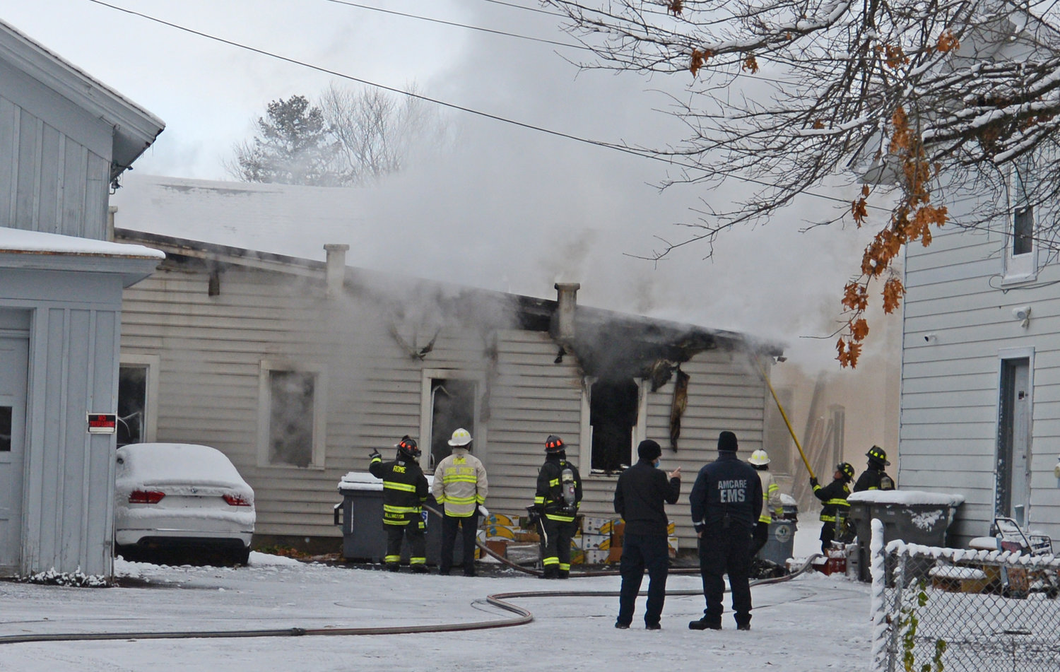 BUILDING DAMAGED — Rome firefighters clear the smoke and douse the flames on the south side of Mac Contracting on Scott Avenue Wednesday morning.