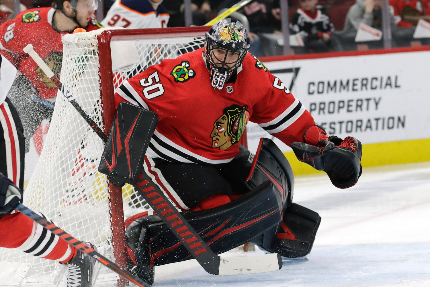 HANGING HIS SKATES UP — In this March 5, 2020, file photo, then-Chicago Blackhawks goalie Corey Crawford watches the puck during the second period of an NHL game against Edmonton in Chicago. Crawford, who helped the Blackhawks win two Stanley Cups, retired Saturday less than three months after signing with the New Jersey Devils and less than a week before the start of the NHL season.