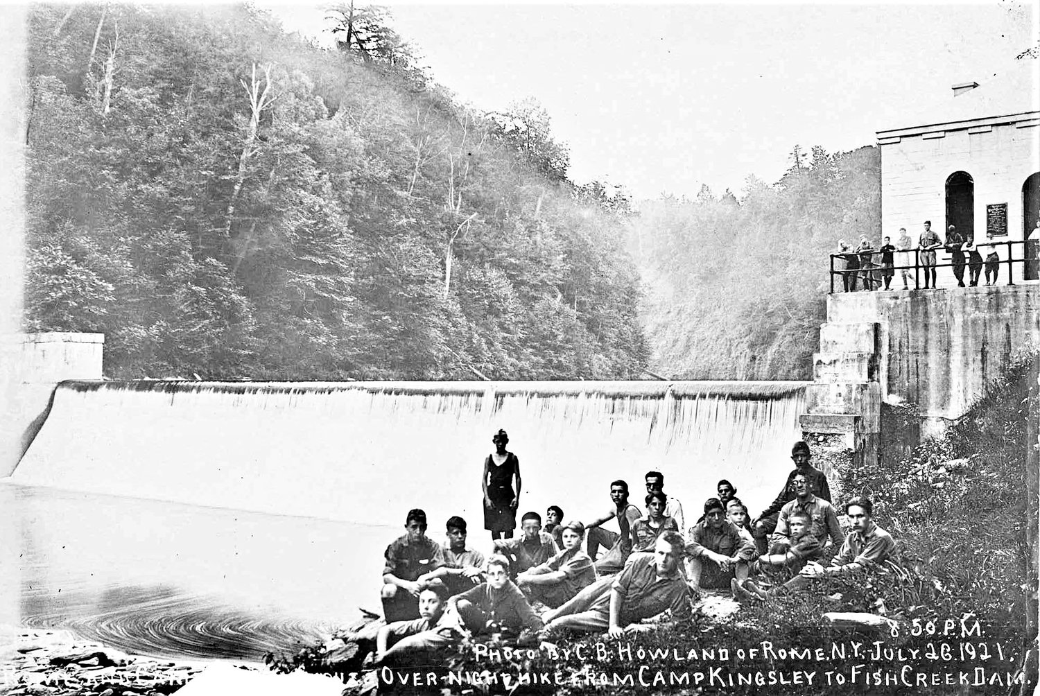 "YOUNG HIKERS — This July 26, 1921, photo by C.B. Howland shows young people who participated in an ""overnight hike from Camp Kingsley to Fish Creek Dam,""according to the caption on the photo. Today, the dam is strictly off-limits to the public. Kessinger Dam was built on the Fish Creek in Annsville in1910, and water was diverted into a hand-dug six-foot wide and one-mile long rock tunnel. A 48-inch pipe carries water seven miles, from the tunnel, to the reservoirs in the town of Lee."