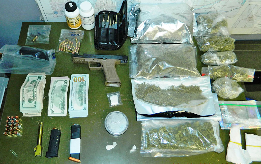 "SEIZED DRUGS AND GUN — Two pounds of marijuana and a makeshift ""ghost gun"" were seized during a traffic stop in Herkimer County by state police."