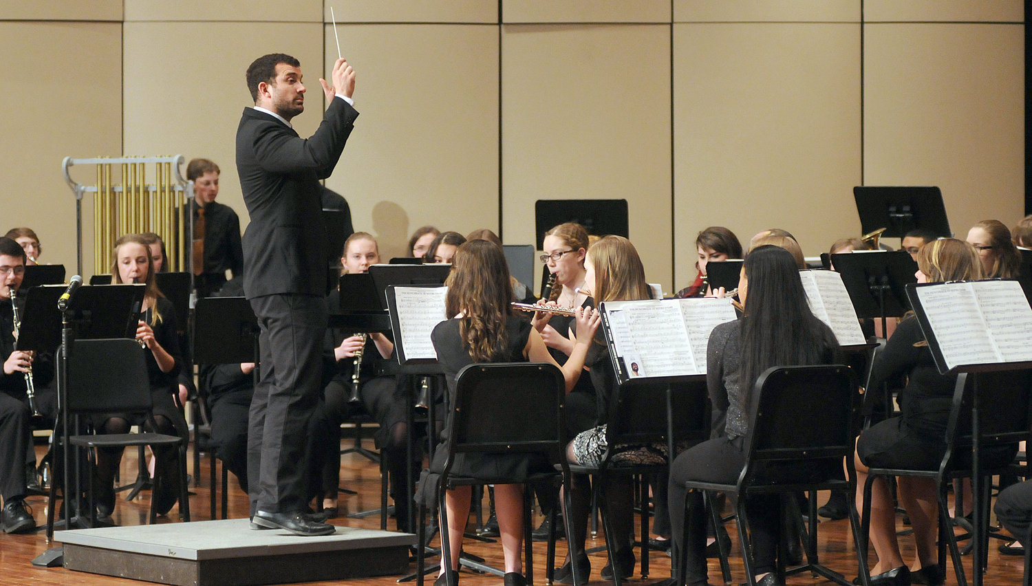 MUSICAL STAFF APPOINTED — Rome Free Academy music teacher Jake Meiss, shown directing the school's Concert Band in this file photo, will direct, choreograph and conduct the orchestra, for the school's production of 'Shrek the Musical.'