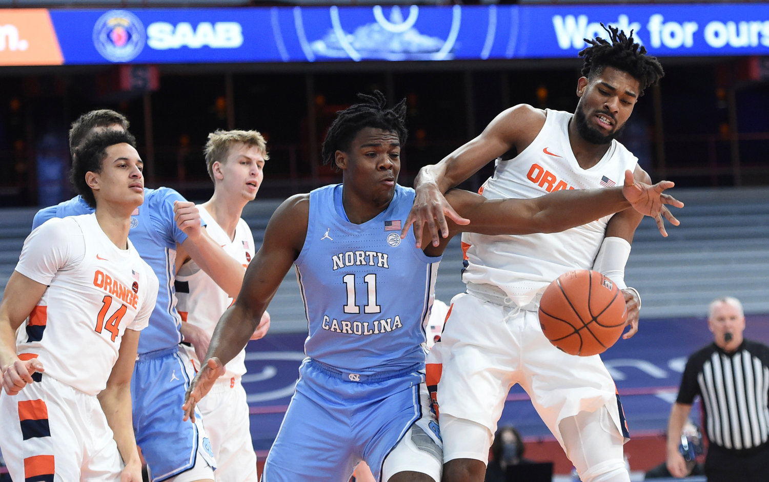 LOOSE BALL — North Carolina forward Day'Ron Sharpe (11) and Syracuse forward Quincy Guerrier, right, work on getting the ball during a college basketball game at the Carrier Dome in Syracuse on Monday night. The Orange won, 72-70.