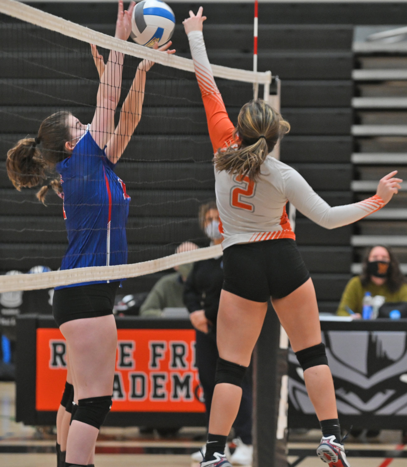 PLAY AT THE NET — Rome Free Academy sophomore Alyce Frost, right, makes a play at the net as New Hartford's Cece Dillion contests during the first set of Monday night's Tri-Valley League game at RFA. Match details were unavailable at press time.