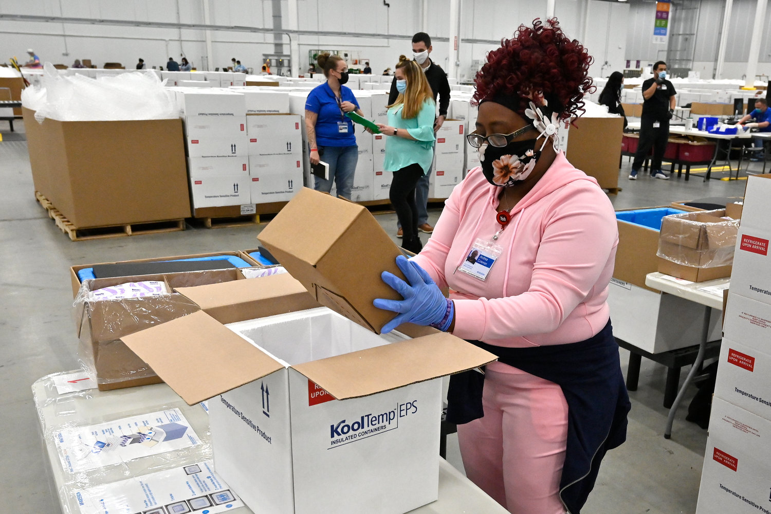 SHIPPING OUT — An employee with the McKesson Corp. packs a box of the Johnson & Johnson COVID-19 vaccine into a cooler for shipping from their facility in Shepherdsville, Ky.