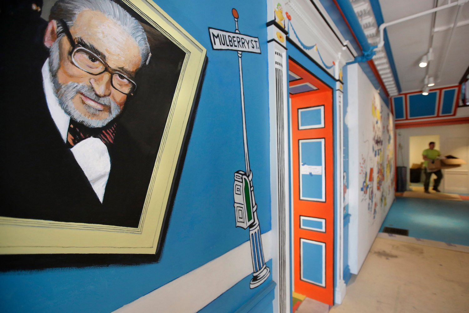 LEGACY — In this May 4, 2017, photo, a mural that features Theodor Seuss Geisel, left, also known by his pen name Dr. Seuss, covers part of a wall near an entrance at The Amazing World of Dr. Seuss Museum, in Springfield, Mass.