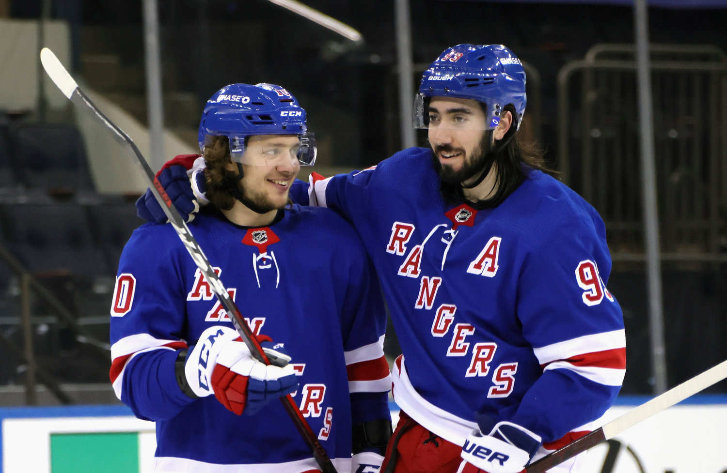 ALL SMILES — Rangers' Artemi Panarin, left, and Mika Zibanejad celebrate the team's 8-4 victory over the Penguins in an NHL game on Tuesday night in New York.