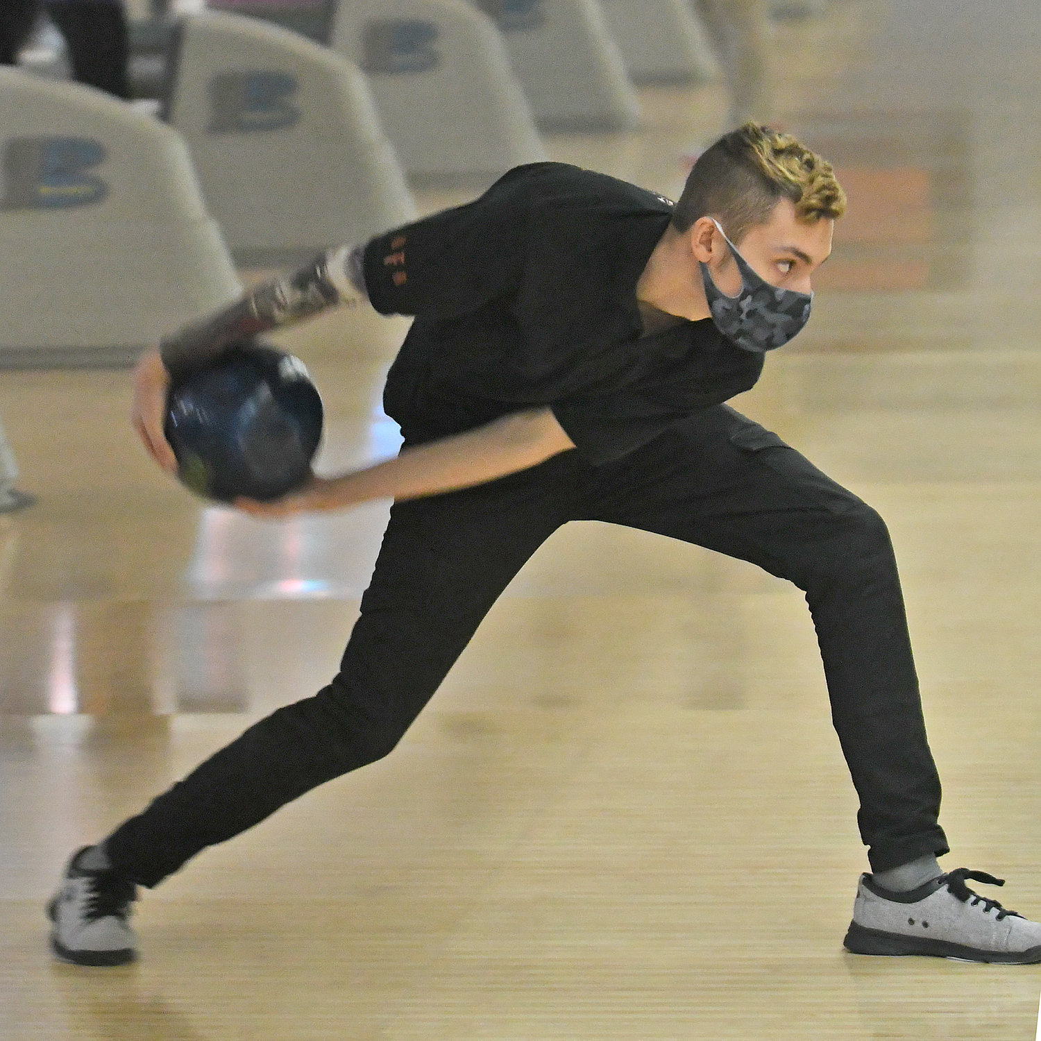 TVL HONOR — RFA senior bowler AJ Poole readies to roll his ball down the lane in a virtual match with Notre Dame on Feb. 9 at King Pin Lanes. Poole has been named a Tri-Valley League first team all-star.
