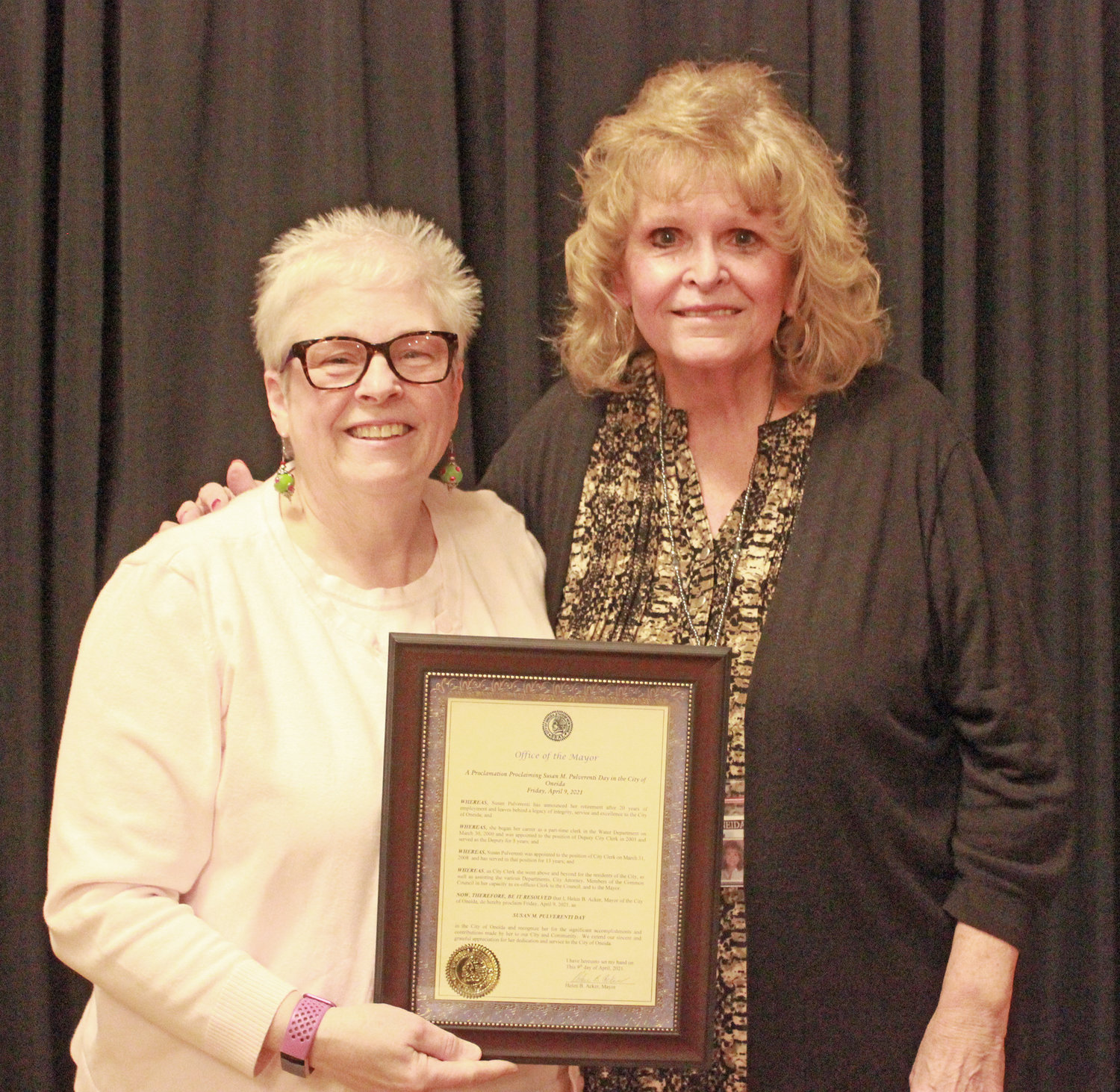 A LEGACY RECOGNIZED — Oneida City Clerk Sue Pulverenti, right, is presented with a proclamation by Mayor Helen Acker declaring Friday, April 9 — her official retirement date — as Sue Pulverenti Day at the Tuesday, April 6 Common Council meeting.