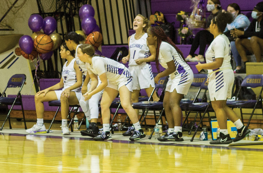 Members of the Lady Brahmans celebrate a teammate sinking a layup.