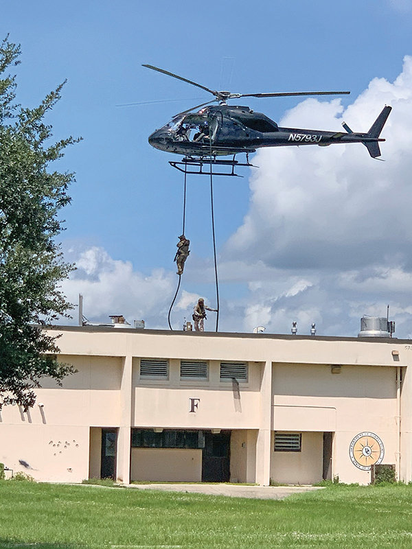 Immokalee Bulletin/Danika J. Fornear: IMMOKALEE — A thrilling helicopter operation demonstration had armed men rappelling onto the roof of a decommissioned maximum-security prison during the launch of the new Force Center.