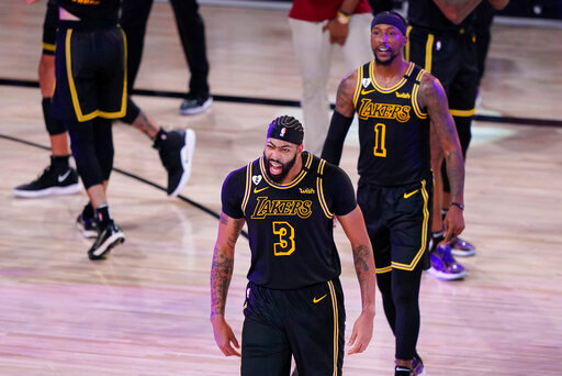 Los Angeles Lakers' Anthony Davis (3) celebrates after an NBA conference final playoff basketball game against the Denver Nuggets Sunday, Sept. 20, 2020, in Lake Buena Vista, Fla. The Lakers won 105-103. (AP Photo/Mark J. Terrill)