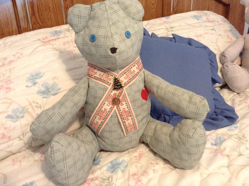 Each bear is wearing a tie made from one of Dick Burns' ties. The tie is held on with one of the late Mr. Burns's pins.