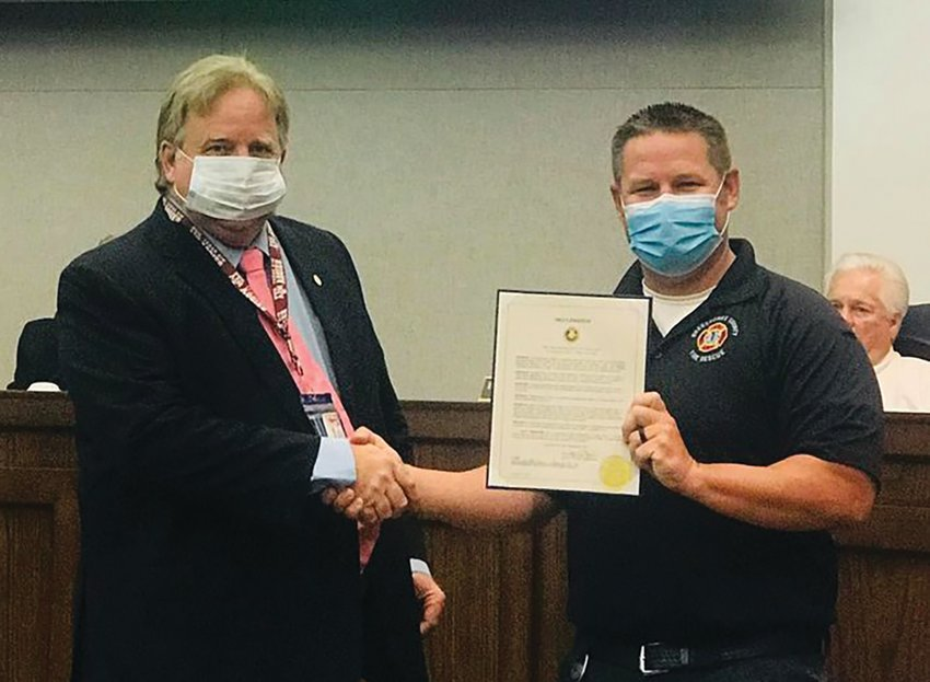 """OKEECHOBEE — On Sept. 24, the Okeechobee County Board of Commissioners presented a proclamation to Capt. Ryan Hathaway, of Okeechobee County Fire Rescue, in recognition of 2020 Fire Prevention Week. This year's theme is: """"Serve Up Fire Safety in the Kitchen."""" This theme effectively serves to educate the public on cooking hazards, the dangers of unattended cooking, and precautions citizens can take to prevent cooking-related fires.  Okeechobee County's first responders are dedicated to reducing the occurrence of home fires and home fire injuries through prevention and protection education. Left to right are Commissioner Brad Goodbread and Capt. Ryan Hathaway."""