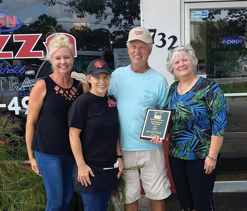 Pictured from left to right: Amanda Nelson, LaBelle Chamber of Commerce president; Carla Davidson and Danny Shoaf, owners of Sal Cal's Pizza; and Diana Fidanza, executive director of the LaBelle Chamber of Commerce.