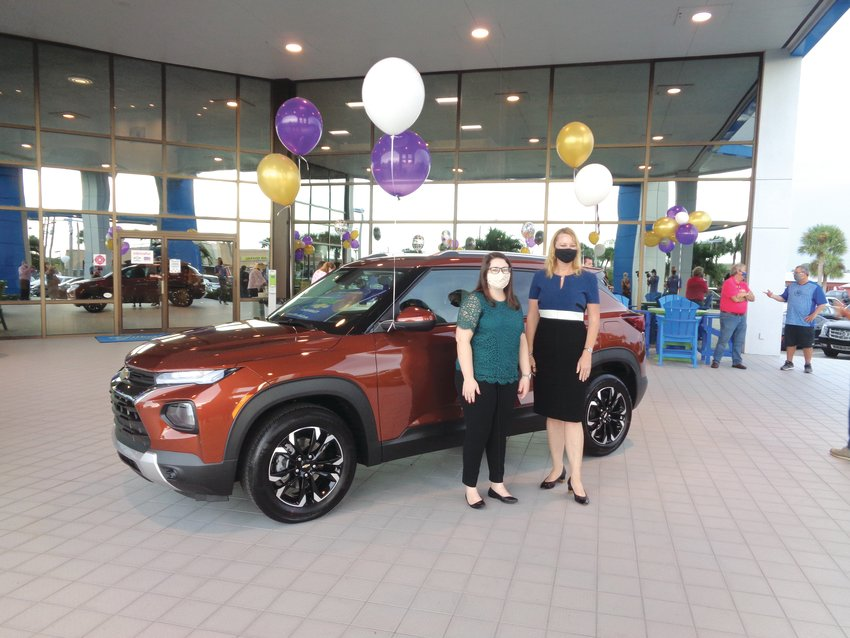 OKEECHOBEE — On Oct. 16, Florida Teacher of the Year Krista Stanley (left) was presented with a free two-year lease on a 2021 Chevrolet Trailblazer by Christa Luna of Gilbert Chevrolet.
