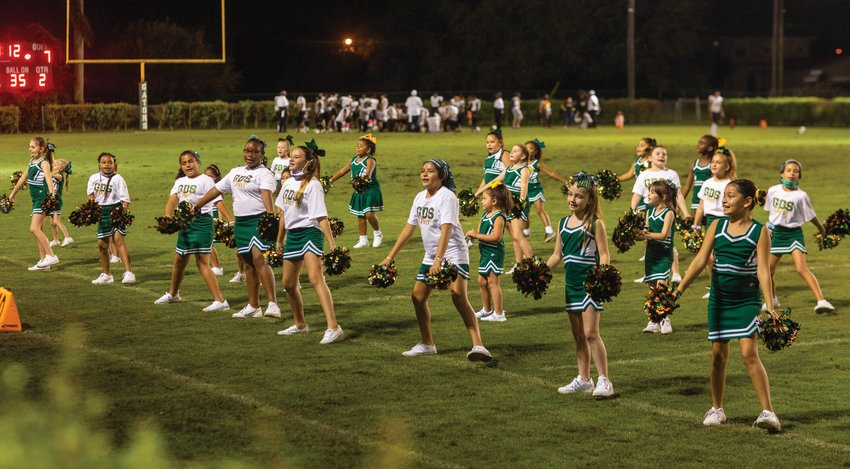The Glades Day cheering squad keeps spirits high during halftime at the Oct. 23 game against Moore Haven.