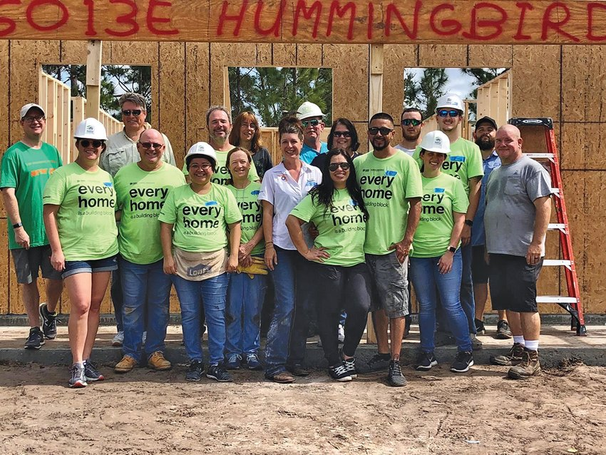 LABELLE — Volunteers from Habitat for Humanity of Lee and Hendry Counties gather for a photo in front of the home they are helping to build.