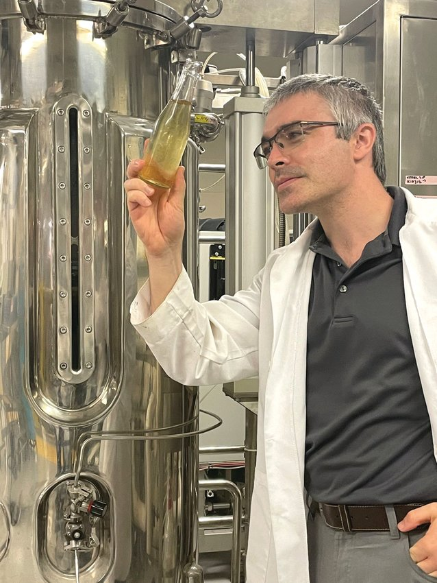 Dr. Andrew MacIntosh, an assistant professor of food science and human nutrition at UF/IFAS, is working with other scientists to find the best ways to carbonate wines. Here, he's seen in his lab in Gainesville.