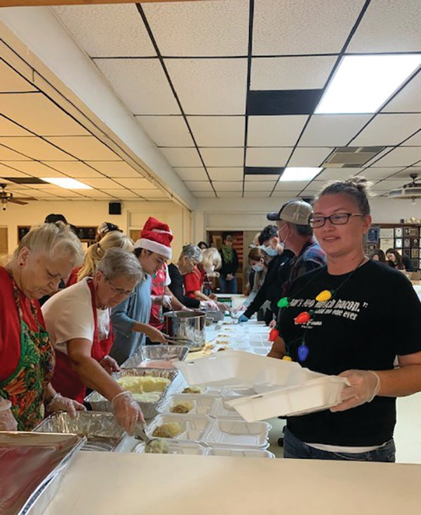 Volunteers at the American Legion help serve over 600 meals.