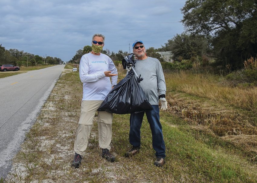 Andy Tomlin (left) and Donald Renfranz, both members of Okeechobee Nature Photographers Facebook Group, spent their morning on the cleanup crew.
