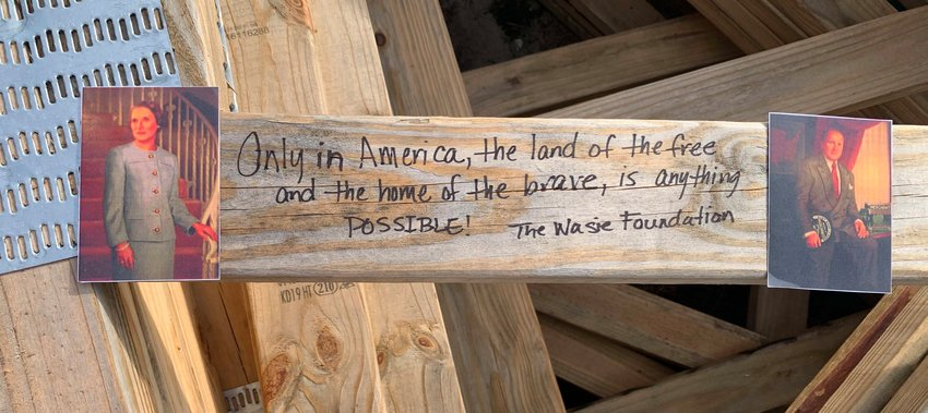 EDU Messages of goodwill 1 - The Wasie Foundation, which underwrote the inaugural home, was represented with an inspirational message on of the home's trusses.