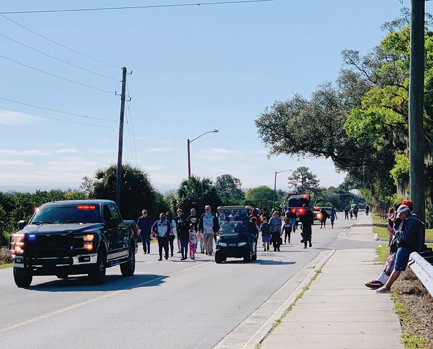 Citizens walk down MLK Boulevard in honor of Martin Luther King.