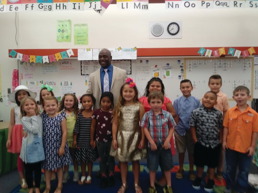 Elementary school teacher Tyrone Smith said only God will get him out of elementary school.
