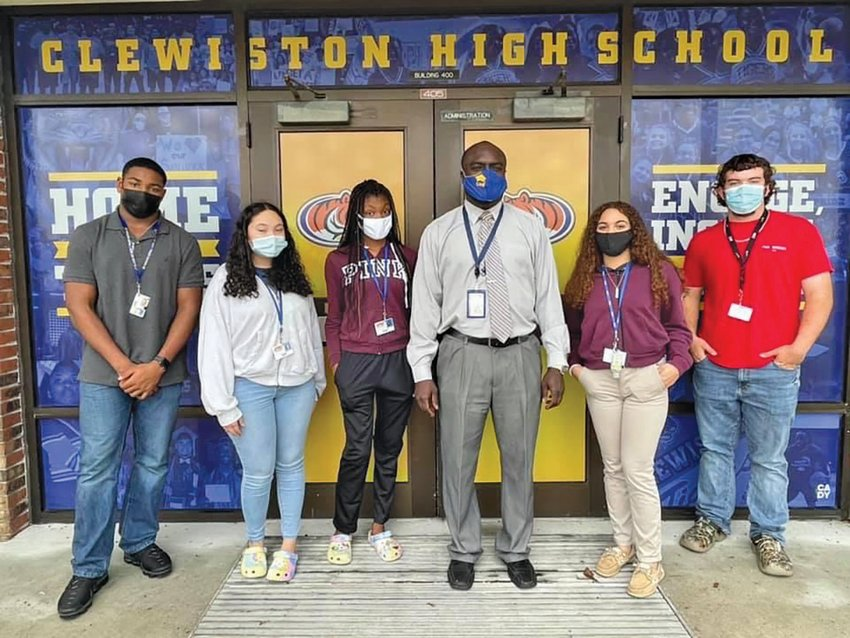 Phil Summers, the new Principal of Clewiston High School, stands with a few of his students