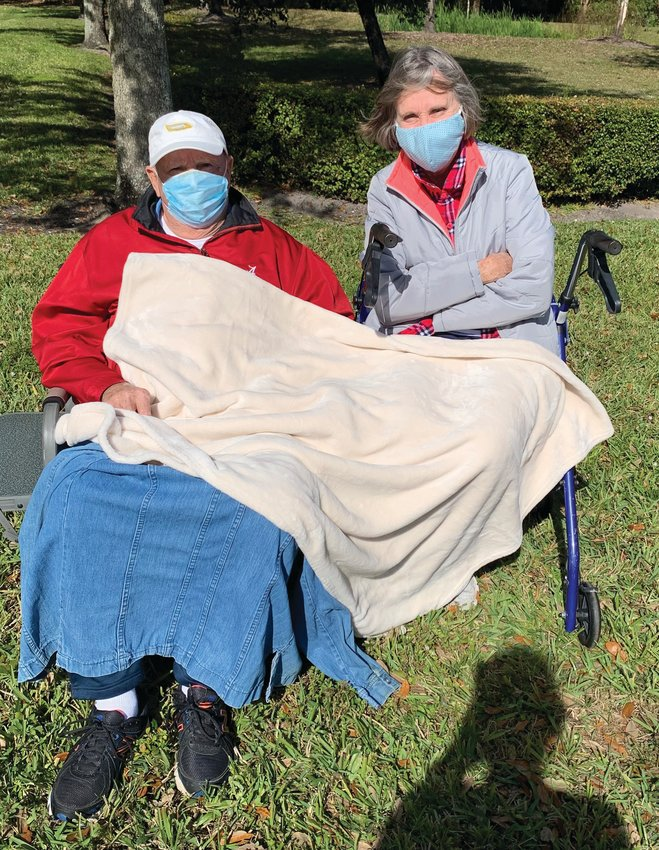 """OKEECHOBEE — Linda  and Gene Hammond arrived just in time to get the last two numbered forms on Saturday. Those waiting were told they could stay in their vehicles, but some opted to set up chairs in the parking lot, """"socially distancing"""" from those not in their household. Some people who arrived after the Hammonds were given """"stand-by"""" tickets, in case someone else left or could not be vaccinated for medical reasons. About 10 of those with """"stand-by"""" tickets were vaccinated."""