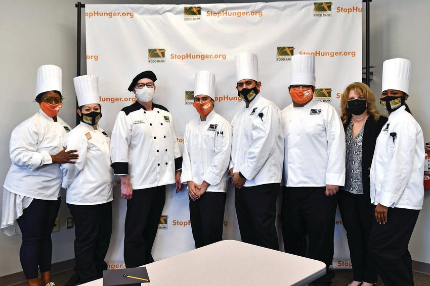 In this graduation photo are Chef Leslie Moyers (third from left) and Treasure Coast Food Bank CEO Judith Cruz (second from right).