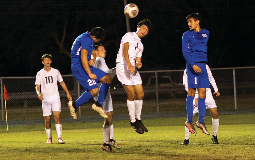 Clewiston sophomore Uriel Paloblanco and Glades Day junior J.T. Ocanas battle for control of the ball during a corner kick.