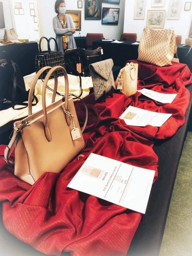 Designer purses wait to be raffled off on February 6, as a fundraiser for Hendry Regional Medical Center.