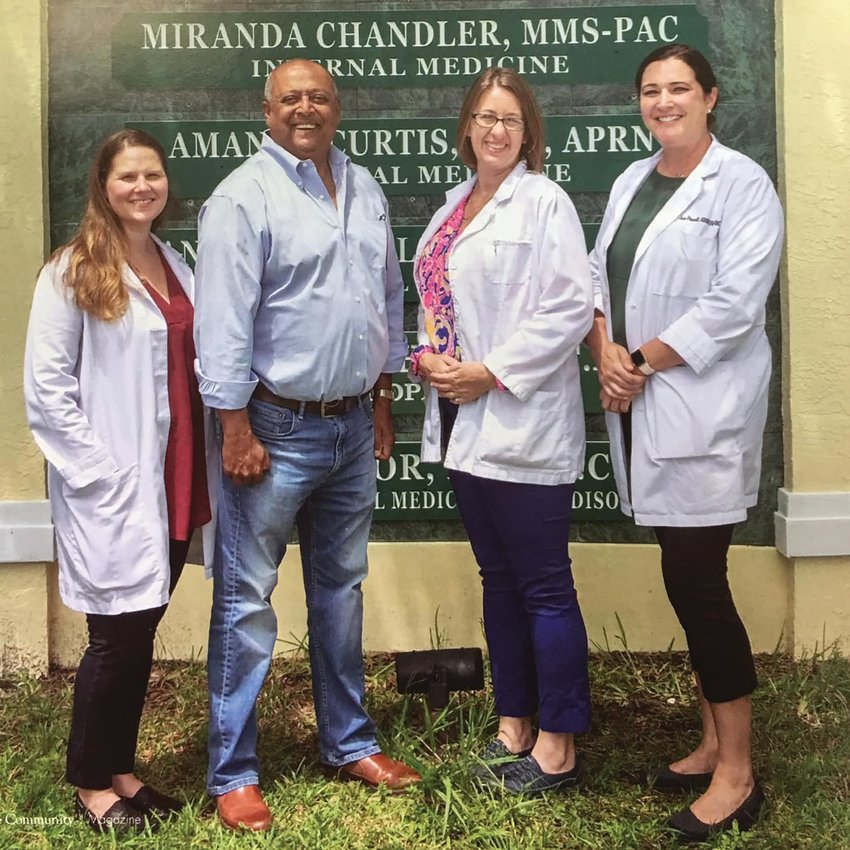 Dr. Saeed Khan is recovering at home after a serious bout with COVID-19. Pictured left to right are Miranda Chandler, Khan, Amanda Curtis and Jane Powell.