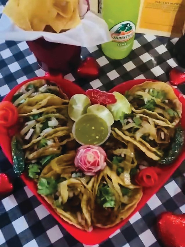 This heart shaped taco platter sits, ready for romance, at Paleteria La Victoria.