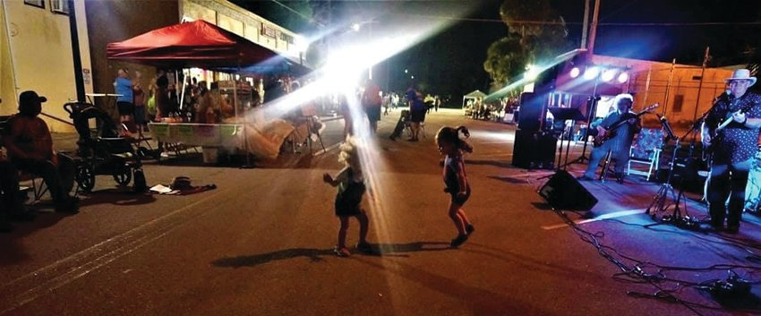 Toddlers enjoying the live music at a past Night on the Town event.