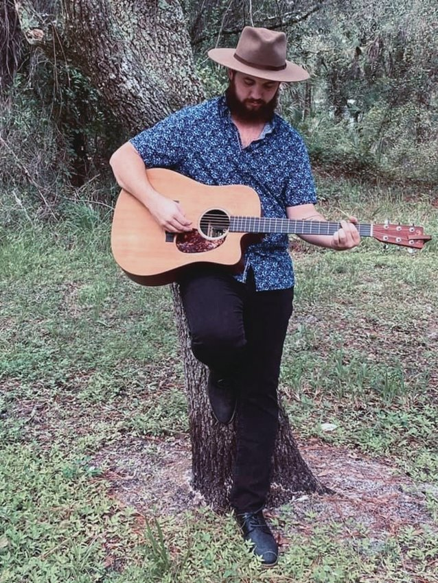 Local Musician, Jack Kaune, plays both original and cover songs.