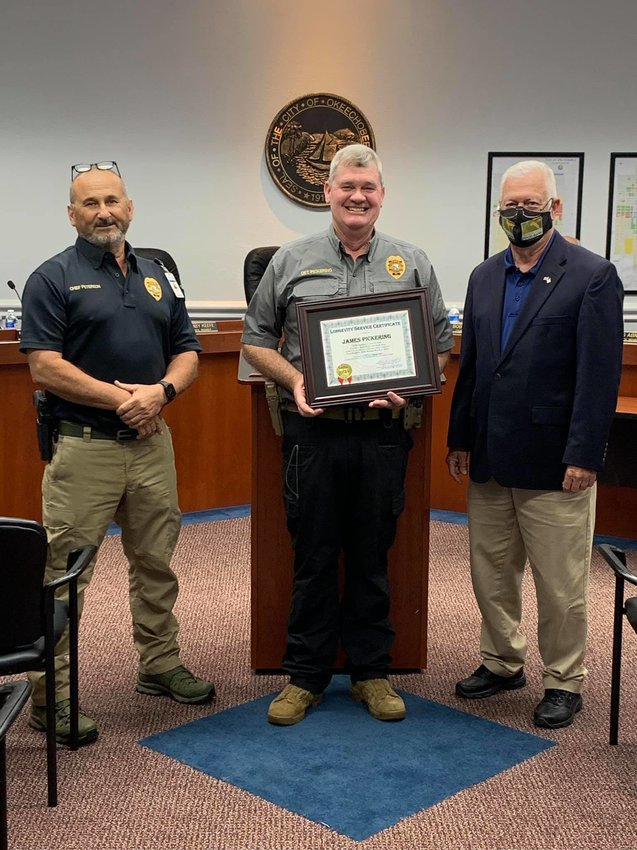 Mayor Watford (right) and Police Chief Peterson (left) present a 15-Year Longevity Service Award to Detective James Pickering at the March 2, 2021 City Council meeting.