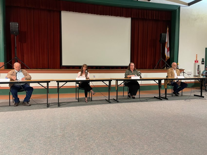 Candidates for city council participate in a forum on March 22 at the Freshman Campus auditorium.