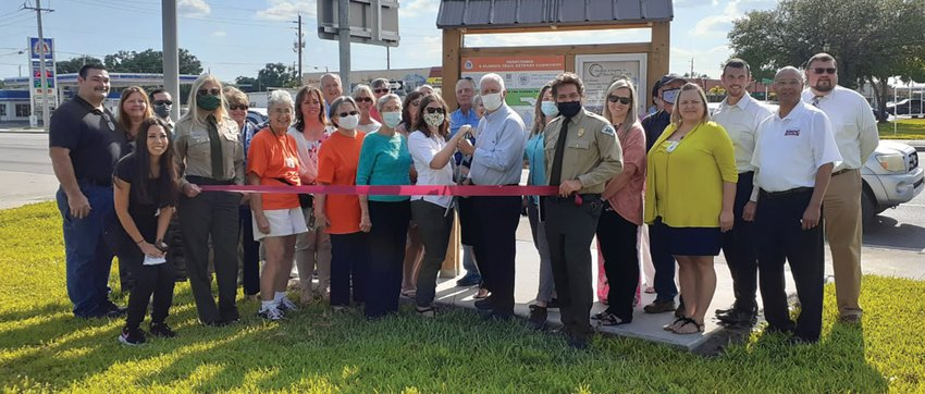 The Florida Trail Association (FTA) revealed their new Gateway Community kiosk panel at the Chamber of Commerce with community, business, state park and FTA volunteers present, Kelly Weiner, Trail Program Director, and Jenna Taylor, Central/South Trail Program Manager shared their excitement to rededicate the city as a Gateway Community.