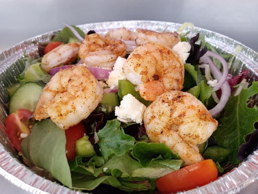 Blackened shrimp salad becomes a new local favorite from The Sassy Bass menu.