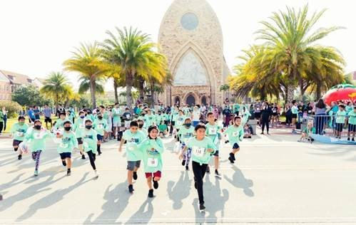 """Immokalee Elementary School students set-off for the kids """"1-mile fun run"""""""