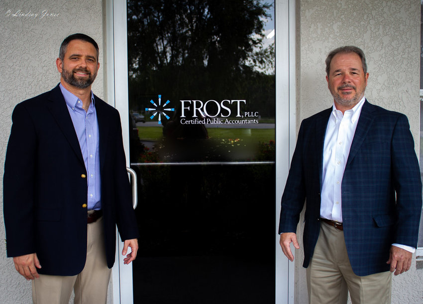 Andrew Jones and Doug Richardson stand outside Frost, PLLC.