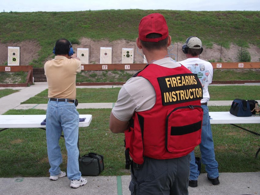 Range instructors ask that visitors not wear red, so instructors in red shirts are easily identified.