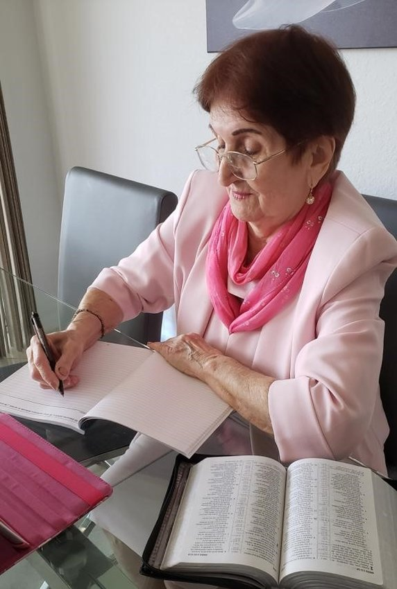 Esther Rodriguez writes at least one letter every day in an effort to share comfort and hope from the Scriptures.