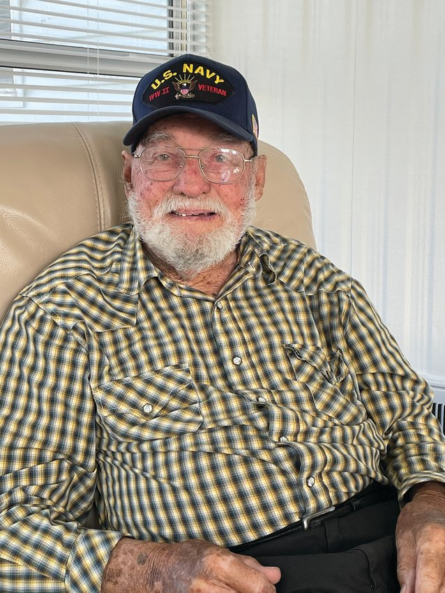 Veteran William Bush (97) mows and weed wacks five yards every week.