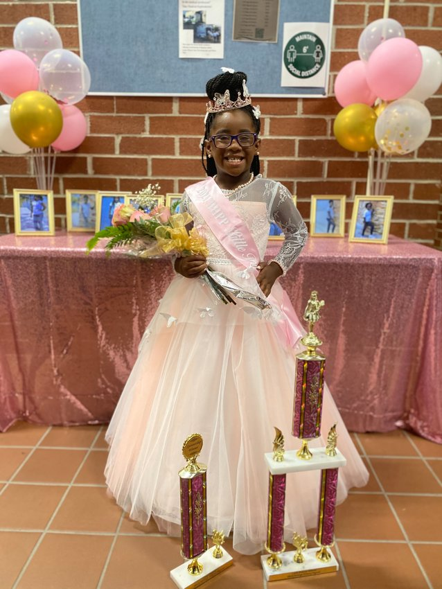 Newly crowned 2021 Black Heritage Princess Diaz'Sha Gunsby shows off all her trophies.